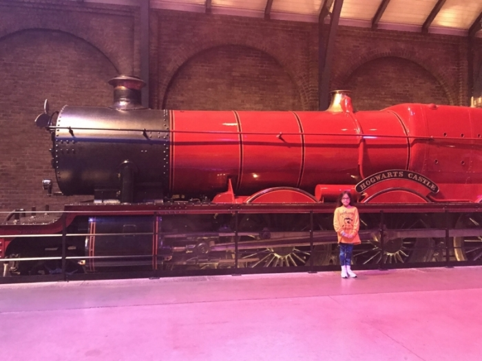 Little Lion in front of Hogwarts Express at WB Studios in London. Posted with permission.