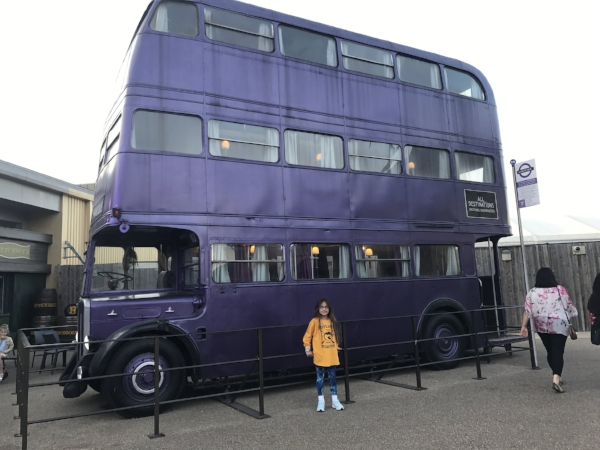 Little Lion in front of the Knight Bus at WB Studios in London.
