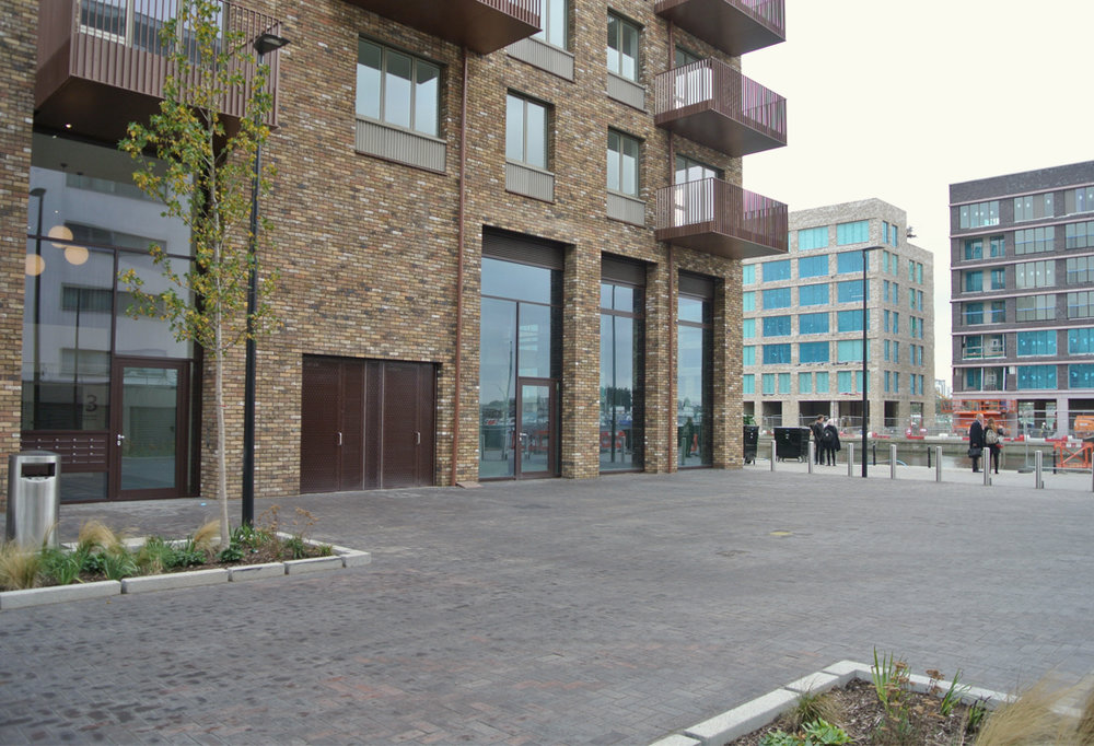 View of the dock approach from Gallions Reach DLR station showing Great Eastern Quays -a.k.a.Royal Albert Wharf phase one.