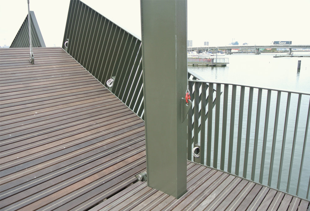 The moving parts of the bridge down touch but float in front of each other creating a tectonic interplay and layering. The narrow Cumaru decking relates to the naturally weathering dockside materials.