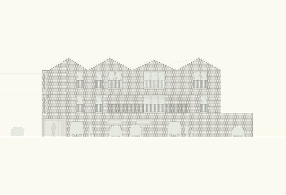 In contrast to the narrow street frontage the long north elevation is characterised by four shallow pitched roofs, creating a domestic character overlooking the carpark.