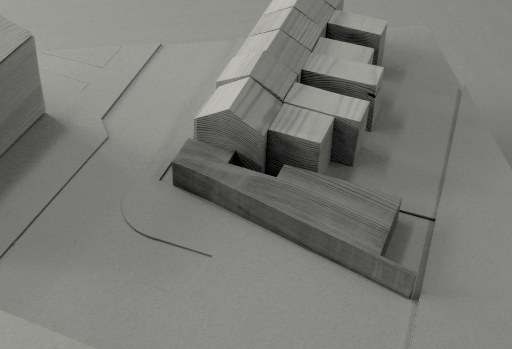 Study model showing the ground floor relationship, cutting back from the neighbouring property to create a light well and privacy court to secondary windows. The building lines the northern edge of the site and steps back on the railway boundary to create a private garden.