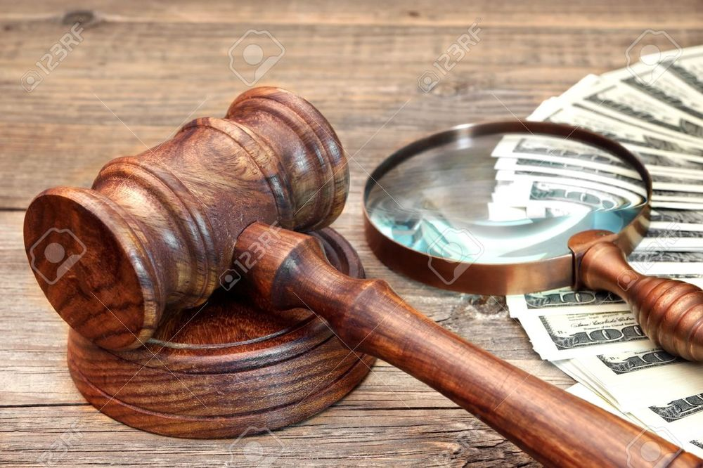 35565813-Gavel-USA-Dollars-and-Vintage-Magnifying-Glass-on-Grunge-Wood-Table-Stock-Photo.jpg
