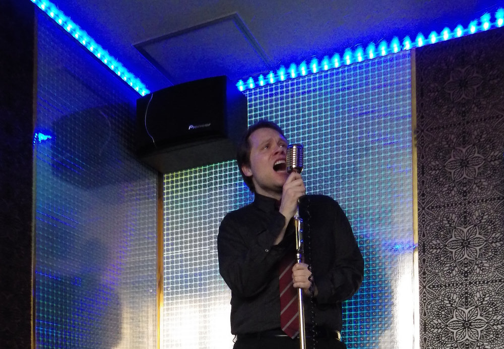 Brightbill keeping his angelic voice in fighting shape at a karaoke box in Shibuya, Tokyo.