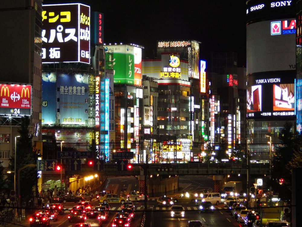 The neon lights of Kabukicho, as seen from a pedestrian bridge over Yasukuni Street in Shinjuku.