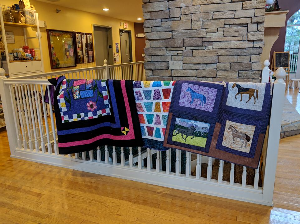 charity quilts delivered to Sunflower house.png