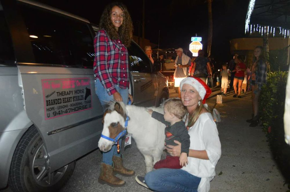 Clayton loved petting the miniature therapy horses from Branded Heart Stables.