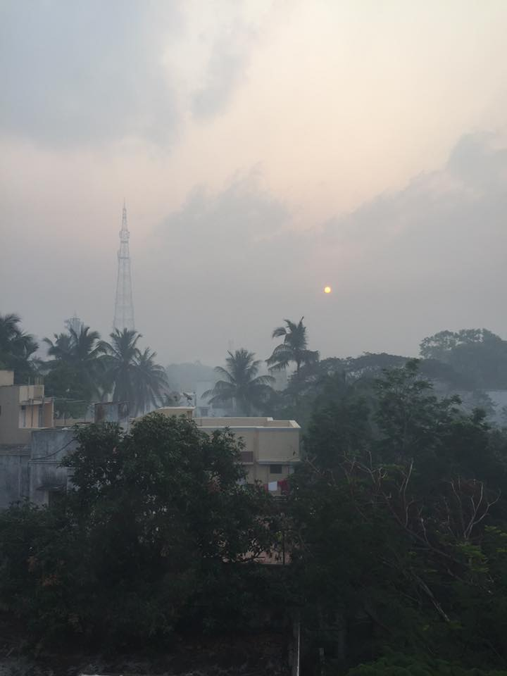 Smoky air on Friday - people were burning symbolic fires to get rid of negativity at the start of Pongal. This is looking out of a window on the 3rd floor of KYM.