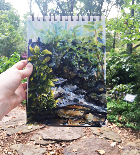 My painting of the stream held up against the forest background. ©2016 by Erin Blumer.