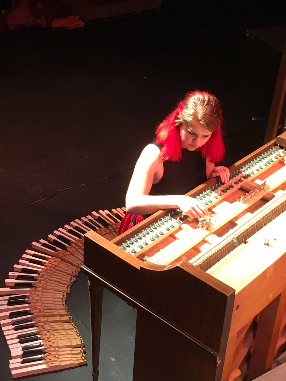 Elizabeth repairs and cleans the piano after the keys began to stick due to humidity in the theatre.