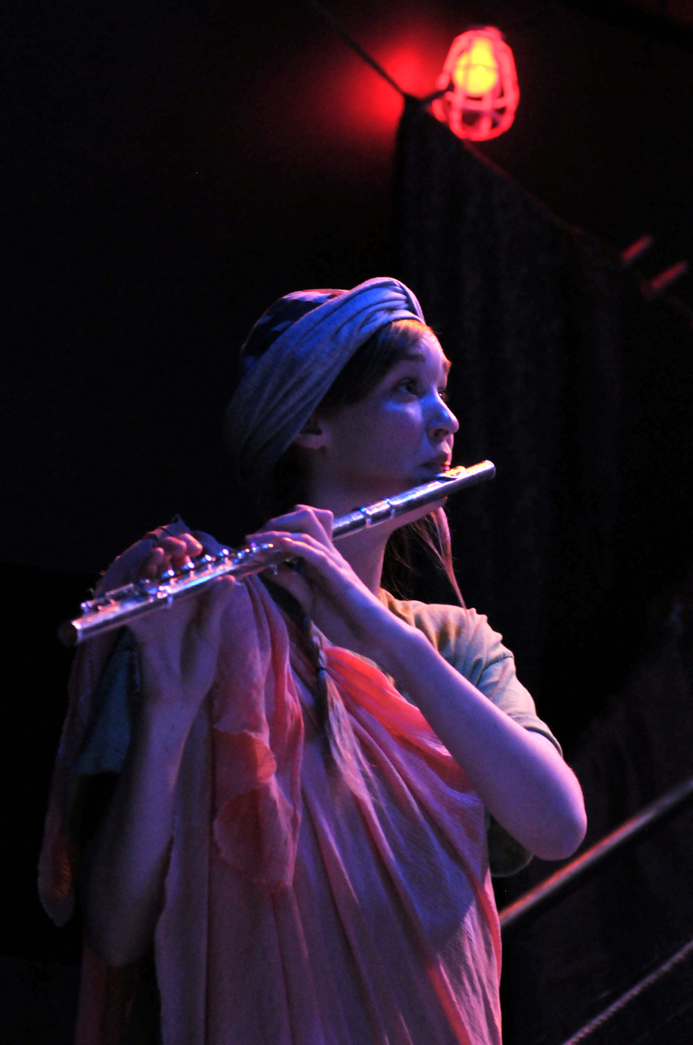 "Kelly Downes plays flute in ""Why Are You Happy?"""