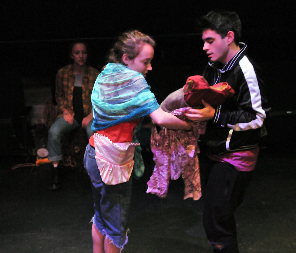 "Madeline Addis and Ben Bailey sing ""I Must Take You"" as Madeline transfers the role of Grusha to Ben.  In this production there were three actors that played the role of Grusha."