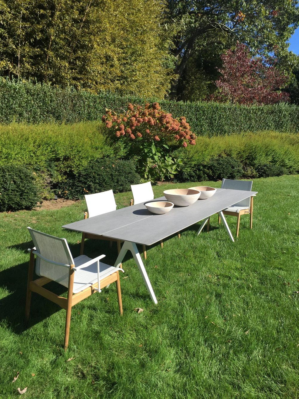 Gloster Split Table + Gloster Sway Chairs in Sagaponack