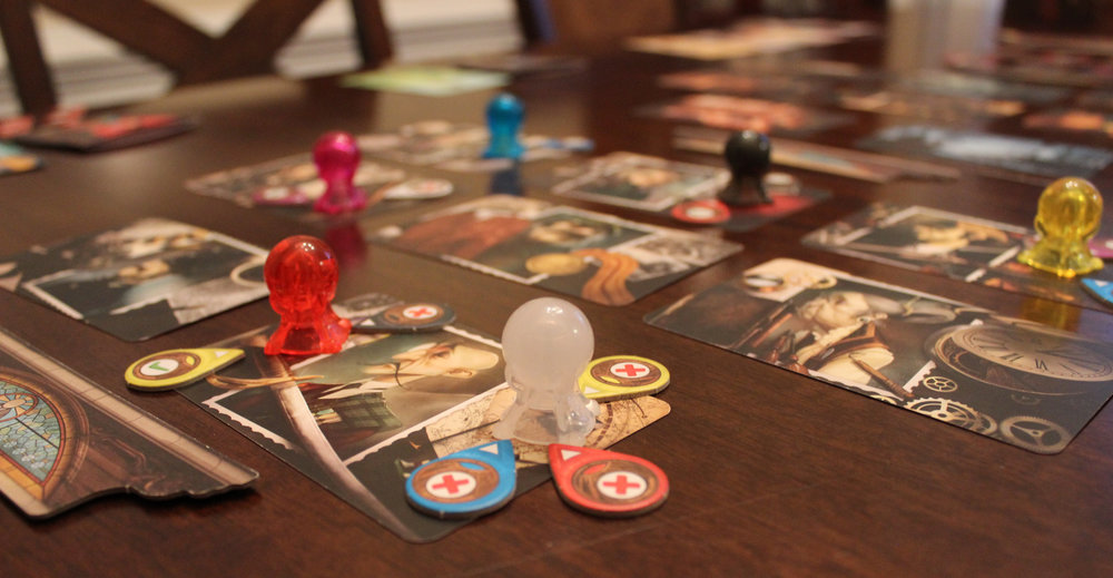 "Players voting on whether they agree with the other player's choices using the teardrop shaped ""clairvoyancy tokens."""