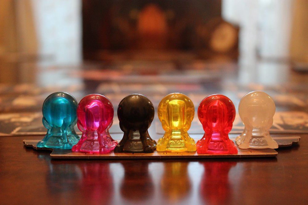 "The crystal-ball shaped ""intuition tokens,"" one for each player."