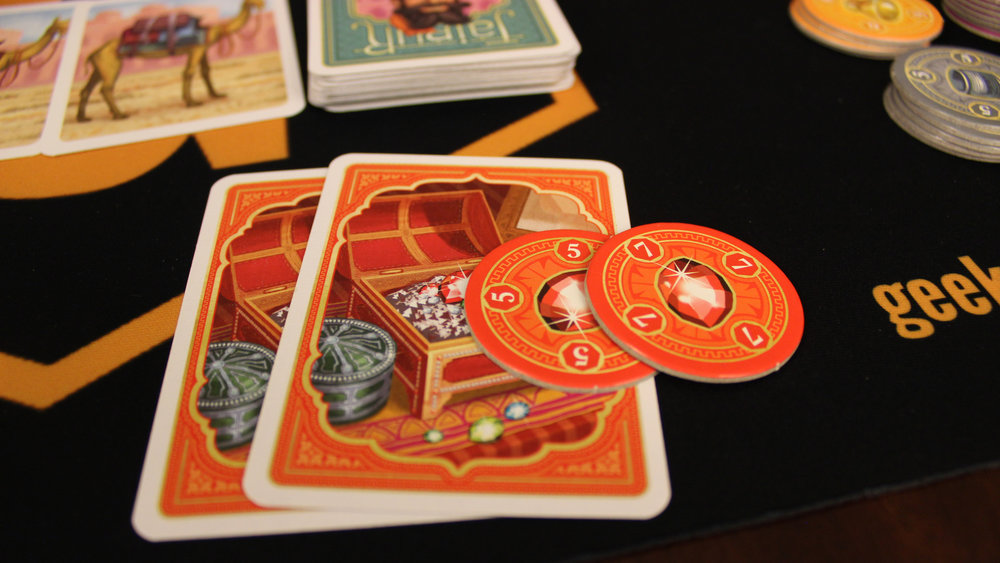 On this turn, the player discards two red jewel cards and takes the top two chips: these act as their points.