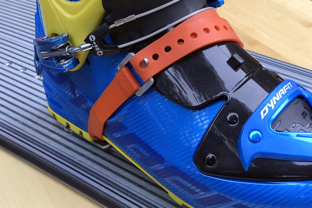"FIGURE 21. Slide a 20"" ski strap through the slotted rails of the risers and secure around your boot for a ""soft"" heel lockdown."