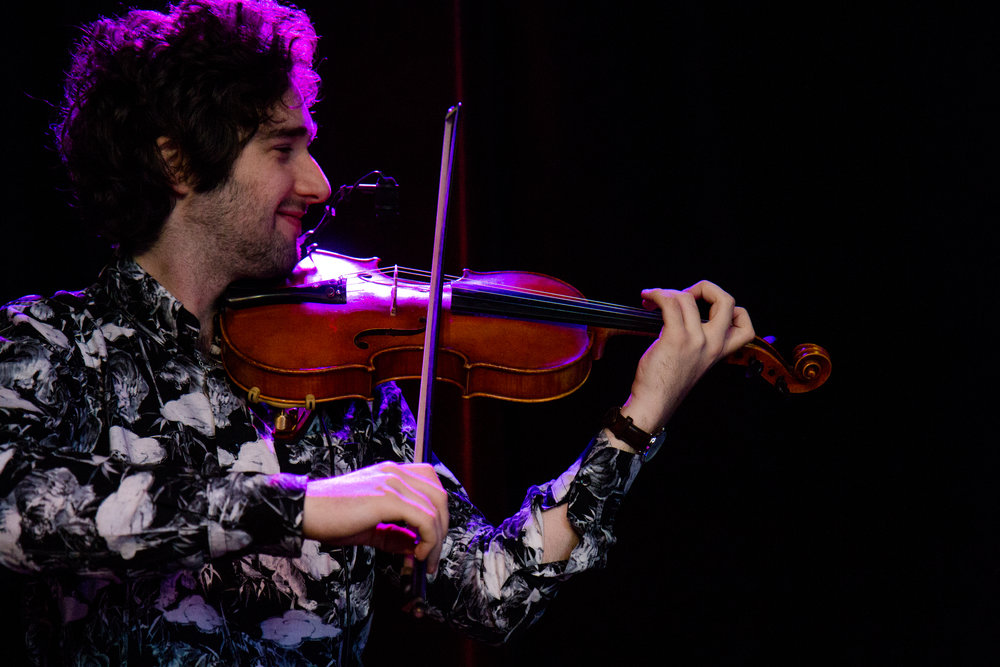 William Lamoureux - William Lamoureux, from Gatineau, Québec, is a violin force to be reckoned with. Whether he's playing in a classical orchestra, in a rock or a country band, in a world music or jazz ensemble, William stands out for his remarkable stage presence, his charisma, his creativity and his excellent technique on the violin. William is involved in a number of musical projects including the Playground Project, the exciting Québec rock group, Billy Love Band, of which he is the founder, the pop-world band Really Big World, the Kalyna Rakel Group and the world music quartet So Long Seven. In addition, he is a featured artist at ONQ Live Entertainment and Bongo and B Entertainement in Toronto. A graduate of the Humber College bachelor of music program, William is also a singer, guitarist, mandolinist and ukulelist.