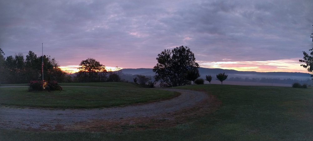 A real life sunrise, as seen from our front porch.