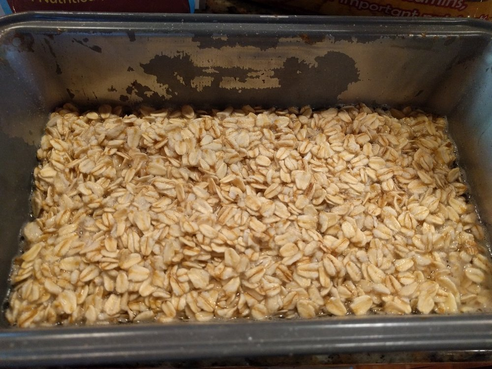 Just enough water to cover the oats. Don't worry about trying to cook them, the hot water will cook them enough.