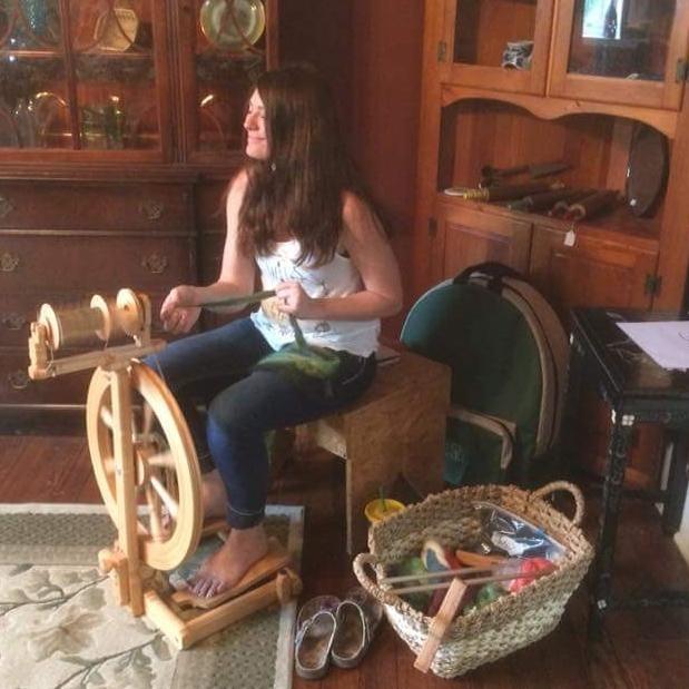 Me at my wheel spinning yarn.