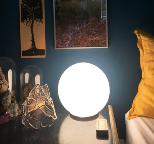 Cloud Strainer  by Melanie Munns sits to the left of Nelly's nightlight within a collection of personal artifacts and references.