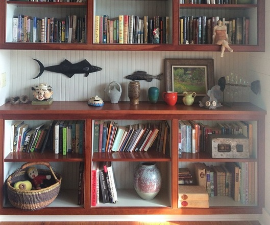 Put art in the in-between spaces (literally and figuratively) like in Vivian and Walter's built-in bookshelf space.
