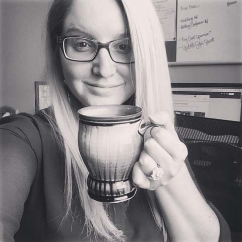 Contributor Liz McIntyre with one of her husband's (Andrew McIntyre) gorgeous ceramic cups.