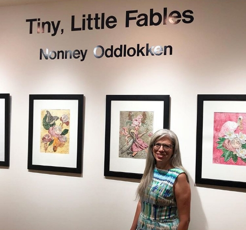 Artist Nonney Oddlokken with her show  Tiny, Little Fables in our gallery within the Gallery, The Roost.