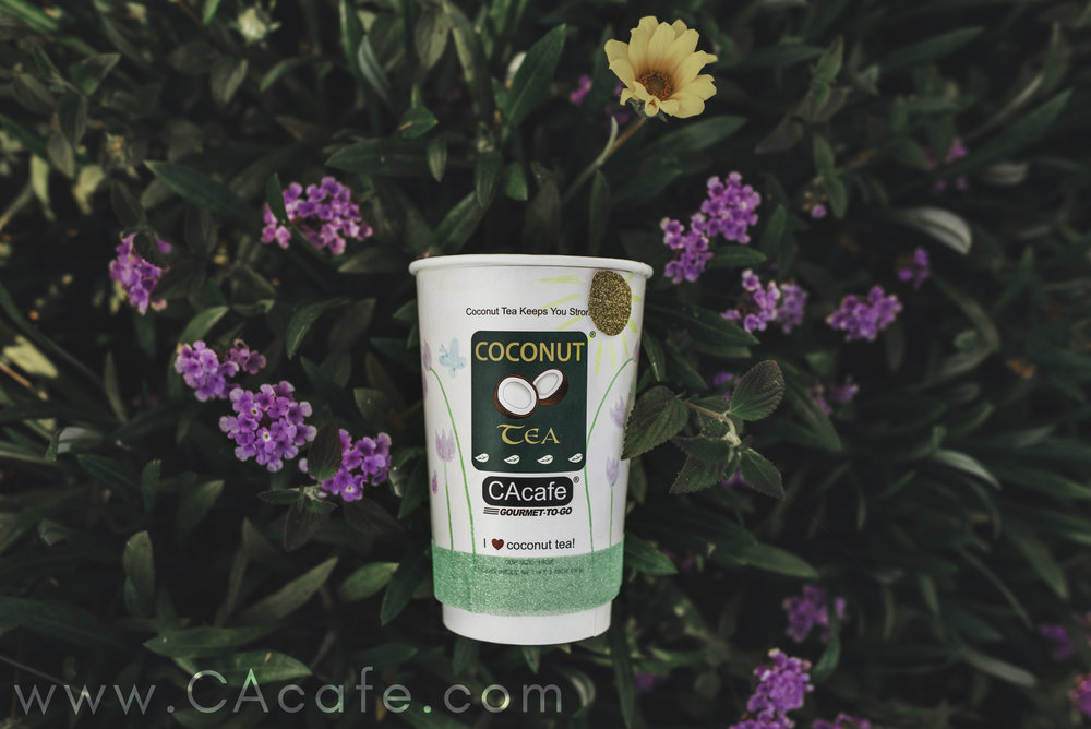 A CAcafe coconut tea to-go cup decorated for Easter