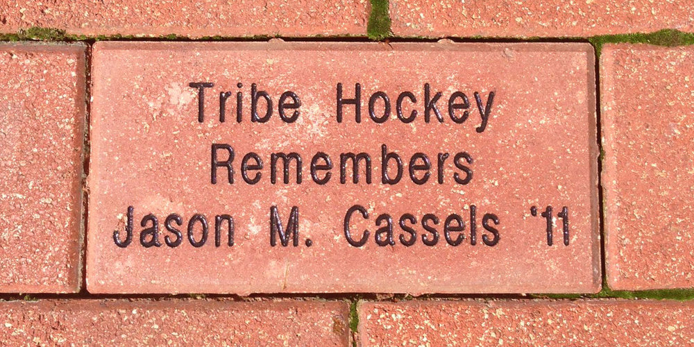 The Tribe Hockey booster club honored Jason Cassels by placing a brick in the Elizabeth J. and Thomas C. Clarke '22 Plaza of the Alumni House in 2013.