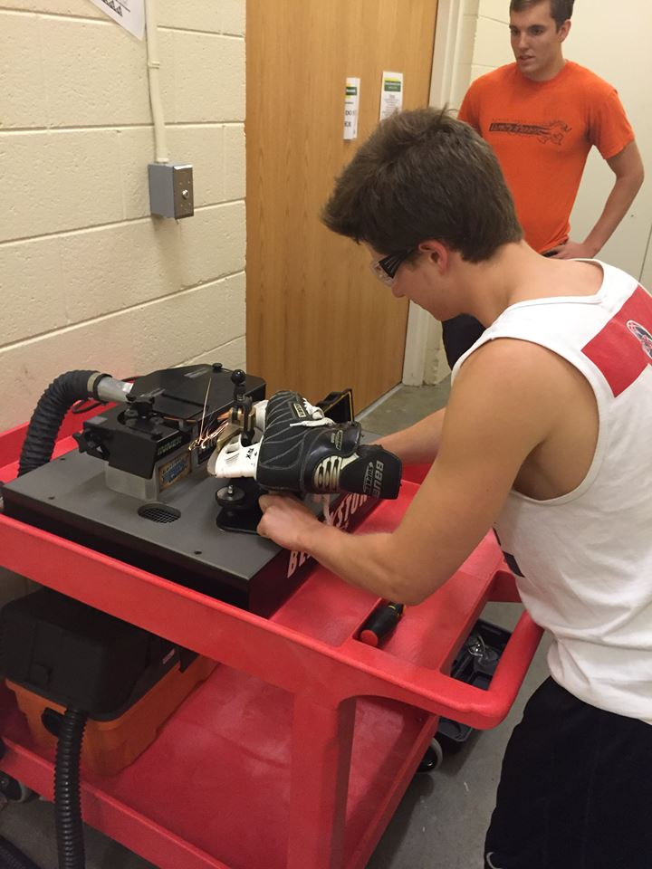 Asst. Coach Simon Zagata (back) and Asst. Captain Conor Rooney christened our Blackstone Sports Flat Bottom V skate sharpener.
