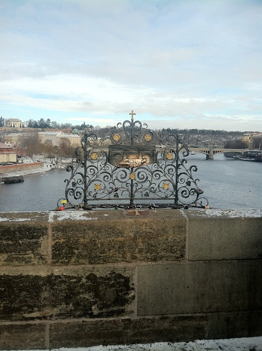 On the Charles Bridge in Prague -- the St. John of Nepomuk memorial that you are supposed to rub for good luck.
