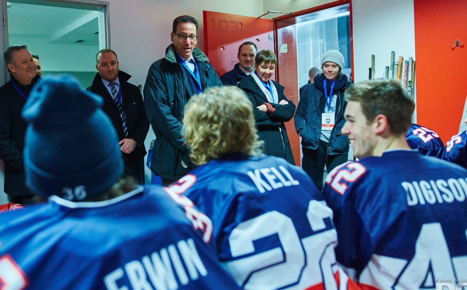 U.S. Ambassador to Slovakia Adam Sterling addresses W&M senior Julian Kell and the rest of the American Collegiate Hockey Association national team before their game in Banska Bystrica, Slovakia. (Photo courtesy ACHA)