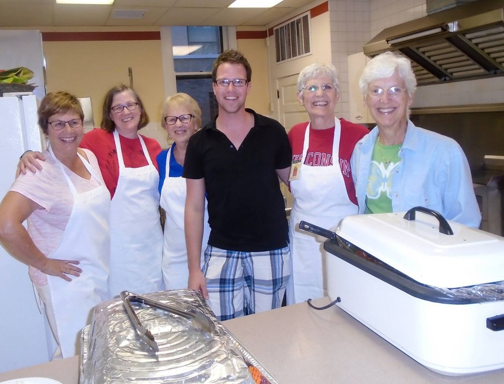 Volunteers having fun in the Grace Kitchen preparing and serving our community's homeless.