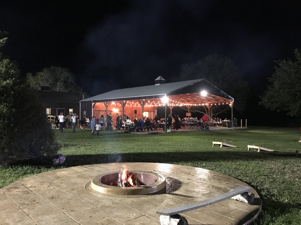 Lots of string lights for your outdoor reception under the covered pavilion. The fire pit is the perfect place to set up a s'mores bar.