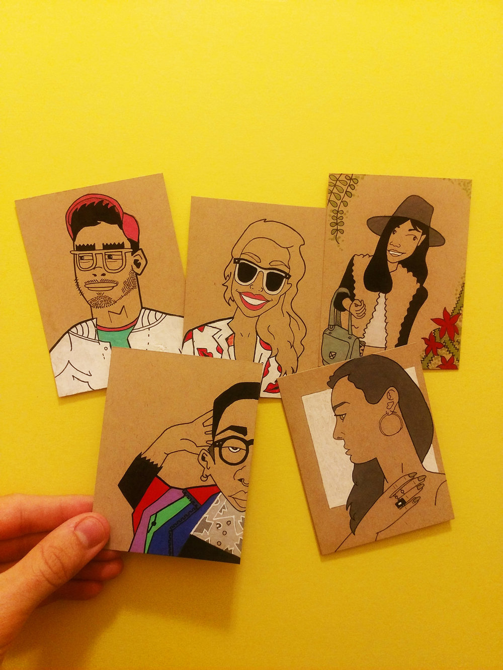 From left to right, top to bottom: Andy, Ricky, Yiwei, Kadie and Lizzy. ( Instagram Buddies  Trading Cards: Series #1); Pen, colored pencil, markers & acrylic paint on 4x3 inch cards of Strathmore toned tan mixed media paper)