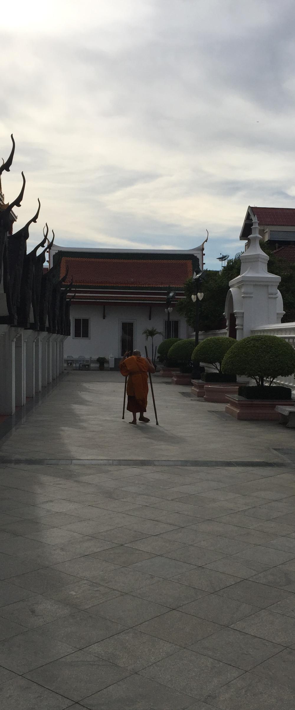 Monk outside Loha Prasat