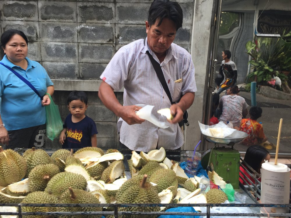 Prepping the most polarizing fruit in Asia.  Durian vendor, near Victory Monument, Bangkok