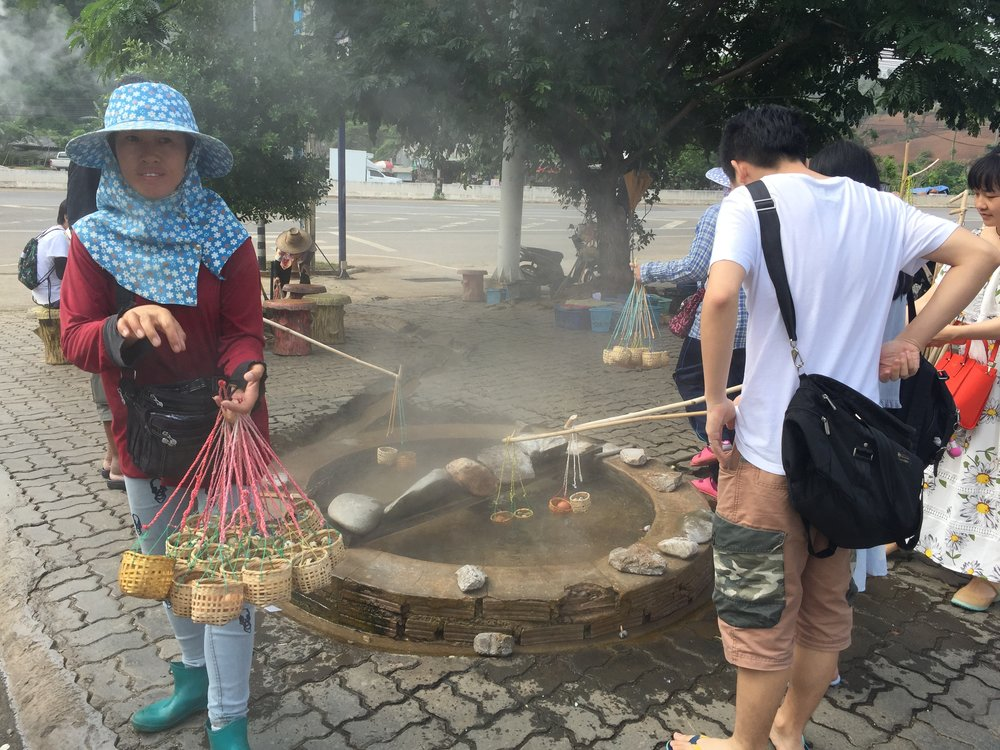 Be glad you can't smell it--worse than durian, even.  Hard-cooking eggs in sulphur hot springs, Chiang Rai province