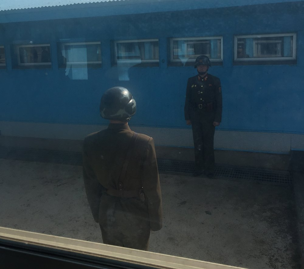 But here's a picture--North Korean soldier facing me from the background, South Korean closer and facing away. And I'm standing in North Korean territory: don't tell the dotard.