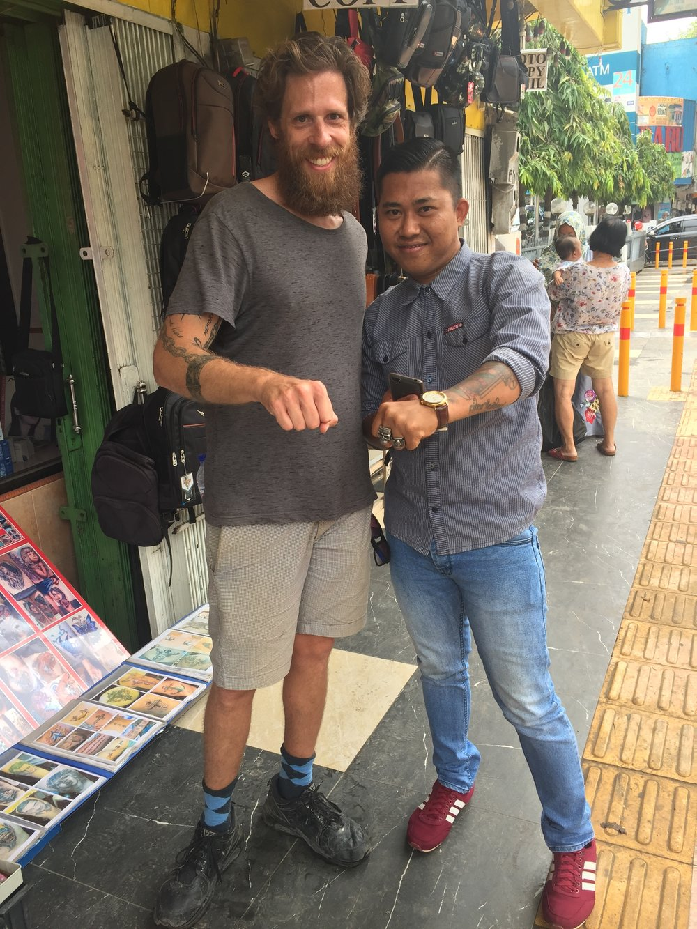 Palembang: tattoo shop owner. Think we have anything in common?