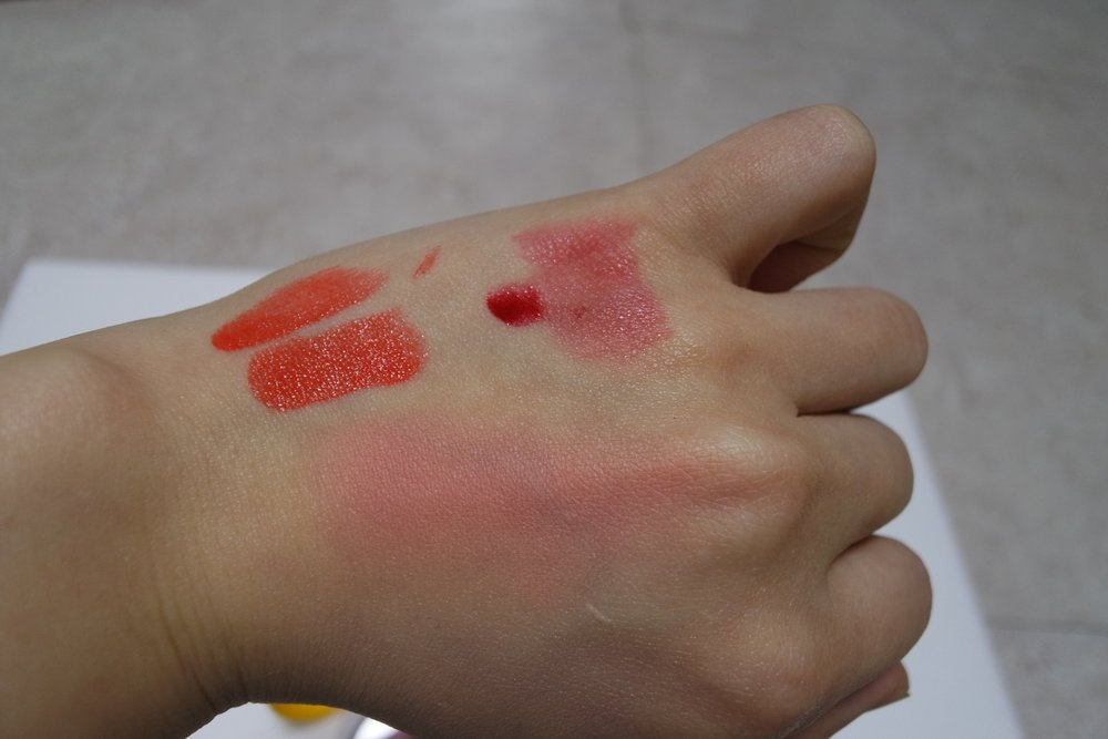 Swatches: TL - Gudetama Melting Lip Button OR02 in one swipe (top) and three swipes (bottom), TR - Gudetama All Night Tint #1 Red Queen, B - Gudetama Jelly Dough Blusher CR01