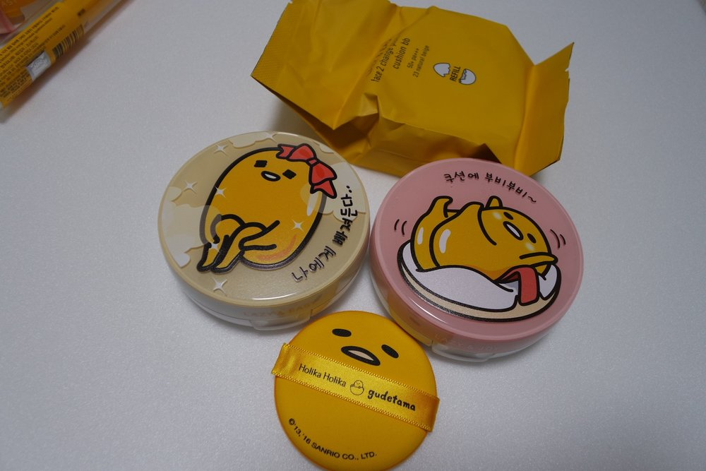 L-R: Gudetama Face 2 Change Photo Ready Cushion BB (15g x 2, #23, KRW 22 900),  Gudetama Face 2 Change Photo Ready Cushion BB Case (#3, KRW 8 000),  Gudetama Sweet Cotton Sebum Clear Pact (9g, KRW 7900) not in photo.