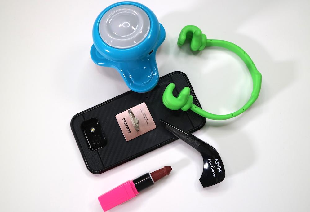 massager, cellphone key ring, penis lipstick, curve eyeliner, cellphone holder