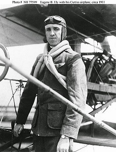 Eugene Ely with his Curtiss biplane.jpg