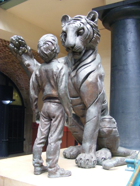 Statue of tiger and boy