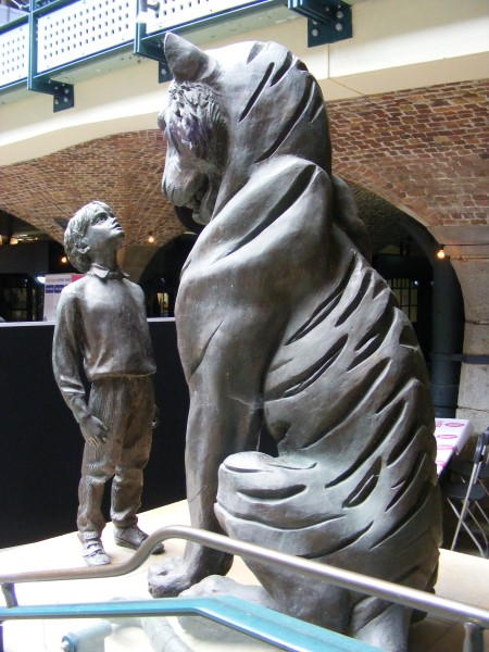 Different view of tiger and boy statue