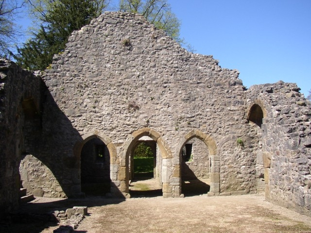 'Doorways to service rooms, Old Rectory, Warton, Lancashire (14th century). These doorways are here seen from inside the hall; the central doorway leads to a passage to an outside door to an external kitchen. The other two doors are to the pantry and buttery' (wikipedia)
