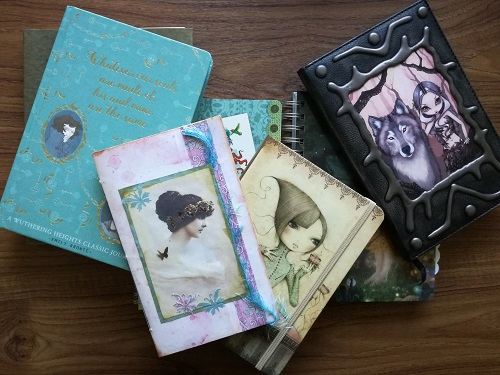 A very small selection of my bought notebooks except the small one on the top of the pile, which is an earlier handmade attempt.